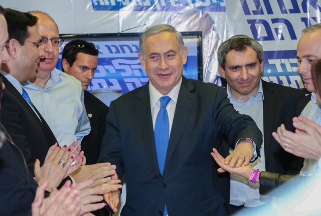 """Israeli Prime Minister Benjamin Netanyahu (C) shakes hands with supporters during a campaign trail in Or Yehuda, Israel, on March 16, 2015. Israeli Prime Minister Benjamin Netanyahu told an Israeli news website Monday that if he is elected in Tuesday's national elections, """"there will be no Palestinian state."""" (Xinhua/JINI/Dani Maron)"""