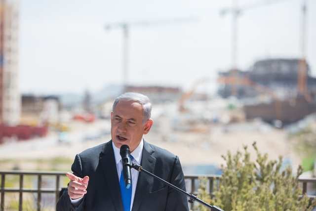 """Israeli Prime Minister Benjamin Netanyahu addresses a campaign trail in the east Jerusalem Jewish settlement of Har Homa, on March 16, 2015. Israeli Prime Minister Benjamin Netanyahu told an Israeli news website Monday that if he is elected in Tuesday's national elections, """"there will be no Palestinian state."""" (Xinhua/JINI)"""
