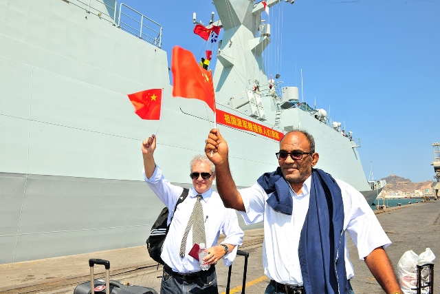 An Egyptian and a Romanian technicians working for Chinese companies in Yemen prepare to board a Chinese navy vessel in Aden Harbor, Yemen, March 29, 2015. China is withdrawing hundreds of citizens from Yemen with the help of Chinese warships, Foreign Ministry Spokeswoman Hua Chunying said Monday. Hua told a daily press briefing that China has already moved 122 citizens from Yemen to Djibouti. (Xinhua/Xiong Libing)