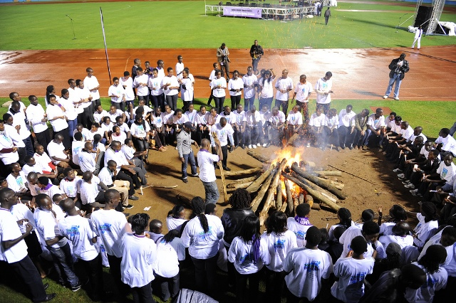 "Youth surround a bonfire during the ?Night Vigil? as part of events to mark the 18th Genocide Commemoration in Kigali, capital of Rwanda, April 7, 2012. Youth use the ?Night Vigil? to remember innocent Tutsis killed in the 1994 genocide. The theme of this year?s anniversary is: ""Learning from our history to build a bright future"". (Xinhua/Cyril Ndegeya) (cl)"