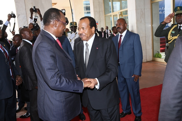 Cameroonian President Paul Biya (R, front) converses with Chadian President Idriss Deby Itno during the Economic Community of Central African States (ECCAS) leaders summit in Yaounde, capital of Cameroon, Feb. 16, 2015. The leaders of ECCAS agreed Monday in an extraordinary summit to provide Cameroon and Chad with an emergency aid of 50 billion FCFA (about 100 million U.S. dollars) to combat Boko Haram. (Xinhua/Fabrice Ngon)