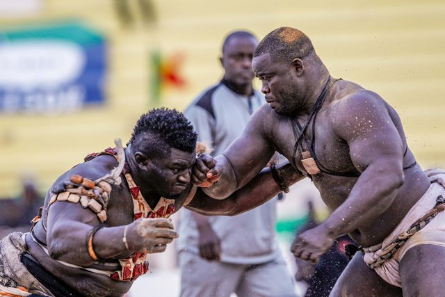 Balla Gaye 2 (L) competes with Eumeu Sene during the Senegalese traditional wrestling match