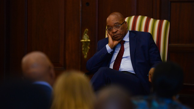 South African President Jacob Zuma listens to a question raised by a journalist during a media briefing after his meeting with leaders of organizations representing foreigners in Pretoria, South Africa, on April 24, 2015. South African President Jacob Zuma on Friday met with leaders of organizations representing foreigners, assuring them of maximum protection. (Xinhua/Zhai Jianlan)