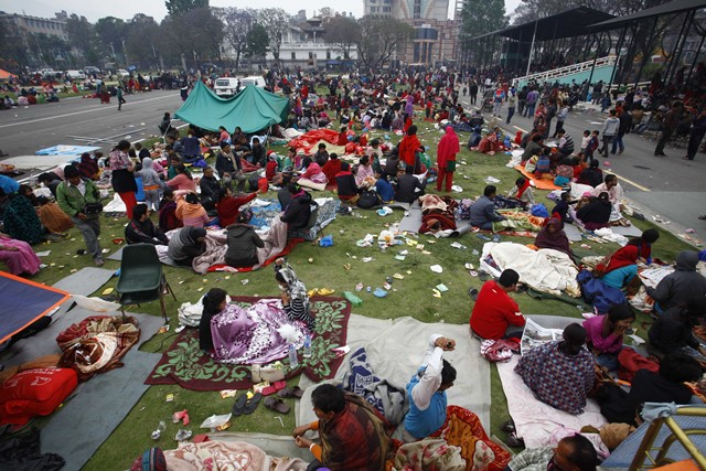 People take shelter at an open space after an earthquake in Kathmandu, Nepal, April 26, 2015. The death toll from a powerful earthquake which struck Nepal on Saturday has climbed to 1, 896 including 723 in the Nepal's capital Kathmandu, a senior government official told Xinhua on Sunday morning. (Xinhua/Pratap Thapa)