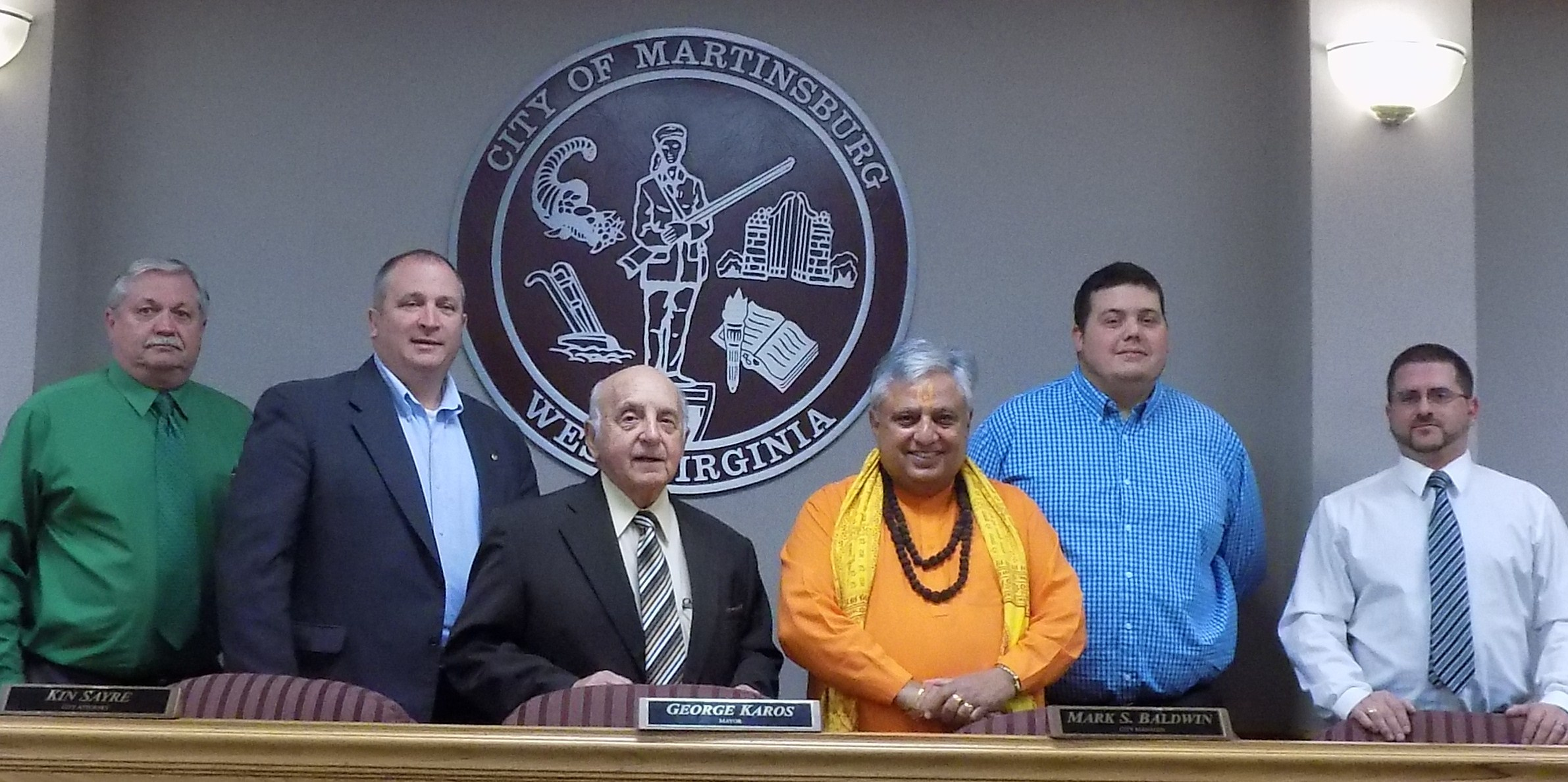 Just before the Martinsburg City Council Hindu invocation; Hindu statesman Rajan Zed (third from right) with Martinsburg Mayor George Karos (fourth from right) and other councilmembers.