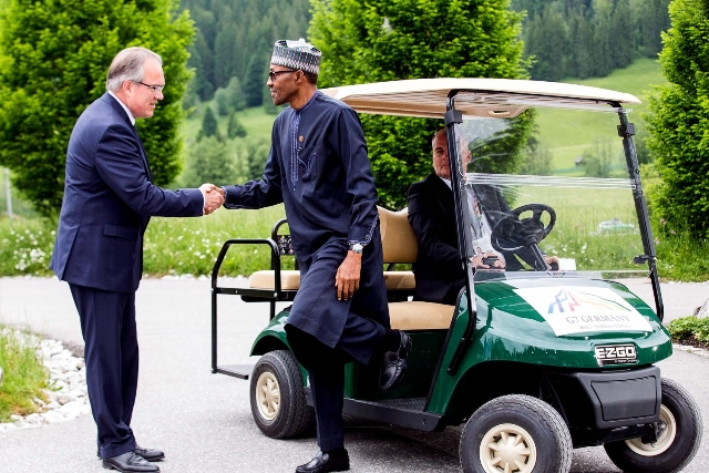 Nigerian President Muhammadu Buhari (C) is welcomed by the German Chief of Protocol, Mr. Juergen Mertuer on arrival for the working session of the G7 outreach programme at Schloss Elmau, Bavavia in Germany, June 8, 2015. (Xinhua/NAN)