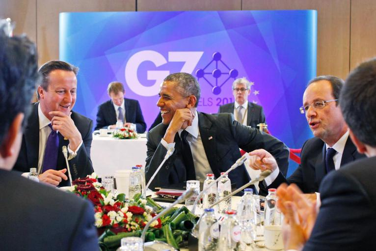 President Barack Obama laughs while talking with at British Prime Minister David Cameron, left, during a G7 session Thursday in Brussels. Charles Dharapak/AP