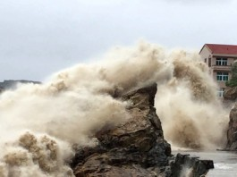 A strong wave breaks on shore ahead of the landfall of Typhoon Chan-Hom in Wenling in eastern China's Zhejiang province July 10, 2015. (Chinatopix Via AP)