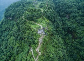 Photo taken on July 3, 2015 shows an aerial view of Hailongtun Fortress in southwest China's Guizhou Province. Tusi sites -- the remains of an ancient political system adopted by Chinese emperors to govern ethnic minority regions in south-central and southwest China -- were inscribed in the World Heritage List on Saturday. The inscribed sites, located in mountainous areas, are Laosicheng in Hunan Province, Tangya in Hubei Province and Hailongtun Fortress in Guizhou Province. Tusi literally means hereditary tribal headmen appointed by Chinese emperors to govern the often unruly ethnic minority regions in the central and western parts of south China, where the specific tribal governance system was adopted from the 13th to the early 20th century. (Xinhua/Liu Xu) (wyo)