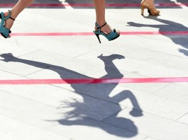 """Participants run during a """"High Heels Race"""" in Taiyuan, capital of north China's Shanxi Province, July 3, 2015. Participants had to run 50 meters in 10-centimeter high heels in the race. (Xinhua/Hu Yuanjia)"""