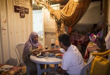 """Palestinians are seen inside their temporary house """"caravan"""" in the southern Gaza Strip city of Khan Younis on July 7, 2015. The 50-day war between Israel and Gaza Hamas-led militant groups ended after Egypt brokered a truce between the two sides. However, people in the coastal enclave still live amid poverty, unemployment and the ongoing endless Israeli blockade. (Xinhua/Wissam Nassar)"""