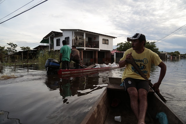 People move in boats in a flooded street in the town of Guasdualito, Apure state, Venezuela, on July 7, 2015. According to local press, more than 9,000 families were affected by the floods caused by the overflowing of the rivers Arauca and Sarare. (Xinhua/Str) (jp)
