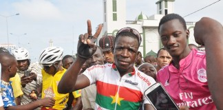 Yameogo Yacouba (2nd R), Burkinabe cyclist poses for a group photo after he won the 12th Benin International Cycling Tour in Cotonou, capital of Benin, July 19, 2015. At least 96 cyclists from Benin, Togo, Burkina Faso, Ghana, Cote d'Ivoire, France, Nigeria, Senegal and Congo took part in 12th Benin International Cycling Tour. The team of Burkina Faso won the trophy for the best Castel team in the competition. (Xinhua/Polycarpe Toviho)