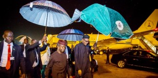 Nigerian President Muhammadu Buhari (1st R) arrives at the Presidential Wing of Nnamdi Azikiwe International Airport in Abuja, capital of Nigeria, July 23, 2015. Muhammadu Buhari returned to Nigeria on Thursday morning after an official four-day official trip to the United States of America. He was received by Nigeria's Vice President Professor Yemi Osinbajo at the Airport. (Xinhua)