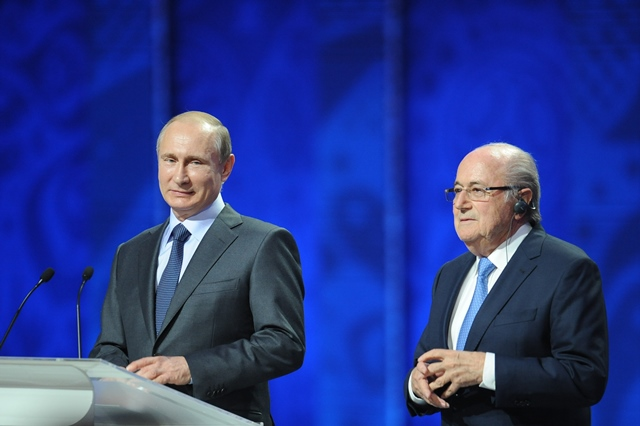 FIFA's president Sepp Blatter (R) stands beside Russia's President Vladimir Putin during the preliminary draw for the 2018 FIFA World Cup at Konstantin Palace in St. Petersburg, Russia July 25, 2015. (Xinhua/Dai Tianfang)