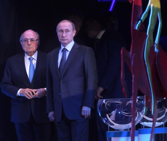 FIFA's president Sepp Blatter (L) stands beside Russia's President Vladimir Putin during the preliminary draw for the 2018 FIFA World Cup at Konstantin Palace in St. Petersburg, Russia July 25, 2015. (Xinhua/Lu Jinbo)