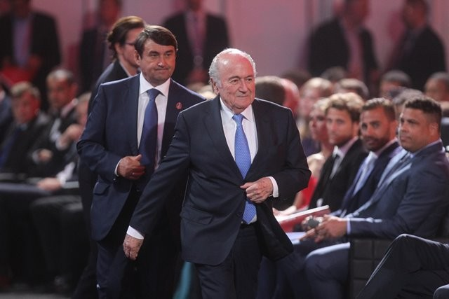 FIFA's president Sepp Blatter (front) attends the preliminary draw for the 2018 FIFA World Cup at Konstantin Palace in St. Petersburg, Russia July 25, 2015. (Xinhua/Lu Jinbo)