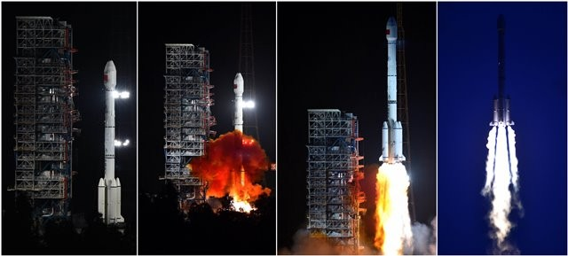 Combined photo taken on July 25, 2015 shows the Long March-3B/Yuanzheng-1 rocket carrying two new-generation satellites for the BeiDou Navigation Satellite System (BDS) blasting off from the Xichang Satellite Launch Center in the southwest China's Sichuan Province. China successfully launched two satellites for its indigenous global navigation and positioning network at 8:29 p.m. Beijing Time Saturday, the launch center said.  (Xinhua/Zhu Zheng)(mcg)