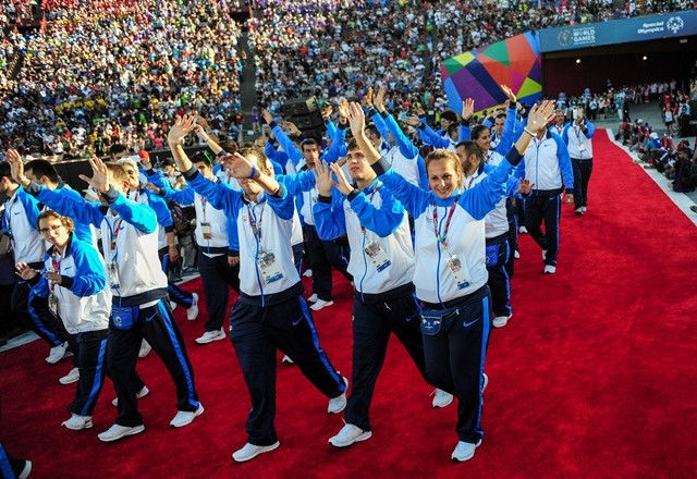 Greece Delegation march into the Memorial Coliseum, during the Opening Ceremony of the Special Olympics World Games in Los Angeles, the United States, July 25, 2015. The 2015 Special Olympics World Games gathers over 6,500 athletes from 165 countries and regions, taking part in 25 events, and lasts from July 25 to August 2.(Xinhua/Zhang Chaoqun)