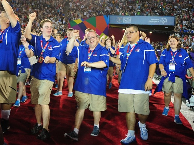 The United States Delegation march into the Memorial Coliseum, during the Opening Ceremony of the Special Olympics World Games in Los Angeles, the United States, July 25, 2015. The 2015 Special Olympics World Games gathers over 6,500 athletes from 165 countries and regions, taking part in 25 events, and lasts from July 25 to August 2.(Xinhua/Zhang Chaoqun)