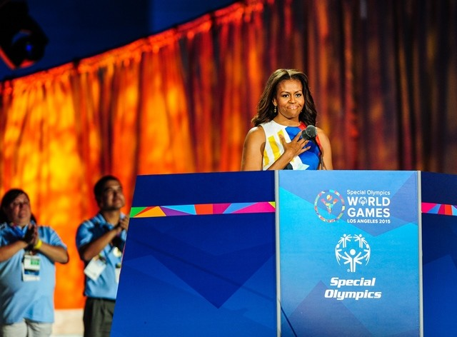 Michelle Obama, First Lady of the United States, presents and announces the opening of the Special Olympics World Games at the Memorial Coliseum, in Los Angeles, the United States, July 25, 2015. The 2015 Special Olympics World Games gathers over 6,500 athletes from 165 countries and regions, taking part in 25 events, and lasts from July 25 to August 2.(Xinhua/Zhang Chaoqun)