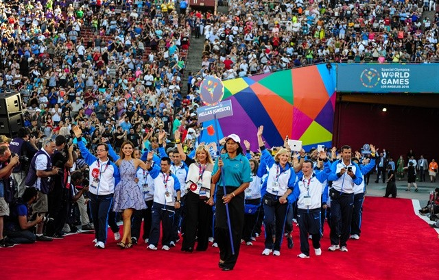 Greek Delegation march into the Memorial Coliseum, during the Opening Ceremony of the Special Olympics World Games in Los Angeles, the United States, July 25, 2015. The 2015 Special Olympics World Games gathers over 6,500 athletes from 165 countries and regions, taking part in 25 events, and lasts from July 25 to August 2.(Xinhua/Zhang Chaoqun)