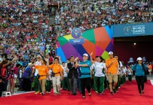 Chinese Macao Delegation march into the Memorial Coliseum, during the Opening Ceremony of the Special Olympics World Games in Los Angeles, the United States, July 25, 2015. The 2015 Special Olympics World Games gathers over 6,500 athletes from 165 countries and regions, taking part in 25 events, and lasts from July 25 to August 2.(Xinhua/Zhang Chaoqun)