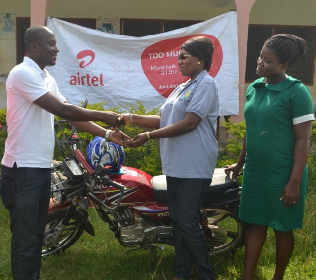 Emmanuel Owusu-Sarfo, Airtel?s Zonal Business Manager for Western Region (Left) presenting the keys to                        the motorbike to Mrs. Joyce Y. Mensah (right)