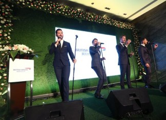 SHANGHAI, CHINA – JUNE 24 _ Brit swing group Jack Pack perform 'Mack the Knife' at British Airways' summer garden party to mark the 10th anniversary of flights to Shanghai