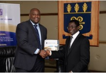 Mr. Leslie Nelson, Chief Executive Officer of GE Ghana in a hand shake withProfessor Kwame Offei Pro Vice-Chancellor of the University of Ghana after the signing of the MOU.