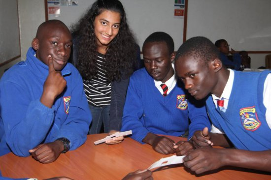 Ayushi Chandaria with Moi Forces Academy boys when she visited to show them how to make flopscope worthy shs.200. ON 29/07/15 PHOTO: JENIPHER WACHIE
