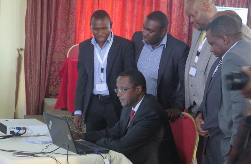 Biruta logs in to Rwanda geoportal web site during the launch yesterday. (Theogene Nsengimana)