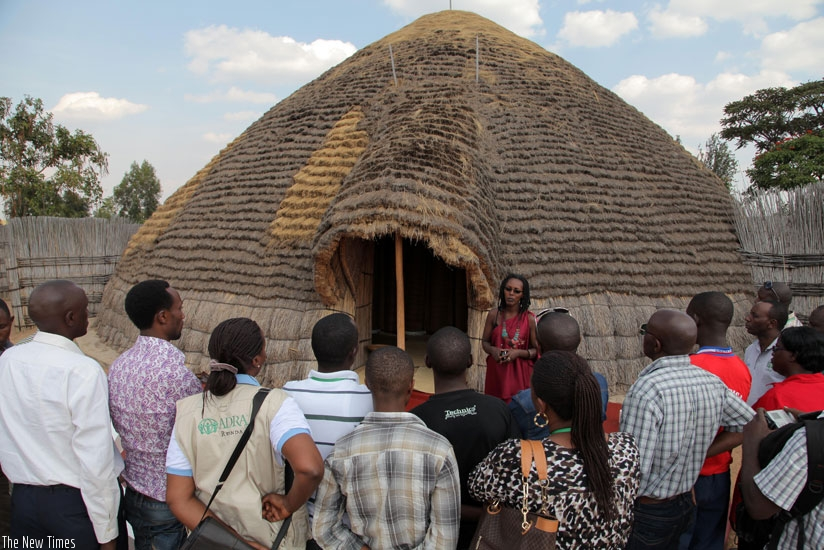 An attendant welcomes visitors at the History Museum in Nyanza. (Fle)
