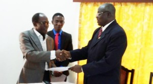 Professor D. D Kuupole (Right) Exchanging Documents With Prof Osei