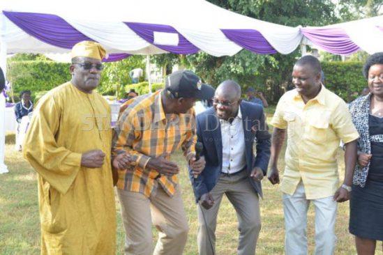 From left: Machakos Senator Johnstone Muthama, MPs Nicholas Gumbo (Rarieda), David Ochieng? (Ugenya) and Gideon Ochanda (Bondo) dance during the pre-wedding ceremony of Siaya Senator James Orengo?s daughter in Ugenya, Siaya County, on Saturday. PHOTO: COLLINS ODUOR/STANDARD