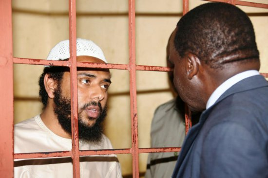 Terrorism suspect Khalid Mohammed Ali (left) chats with his lawyer Jeff Asige at the Shanzu Law Courts on July 22, 2015. His Sh10 million bond was cancelled yesterday.