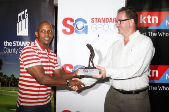 Member of Standard Group Board of Directors Shawn Zambani (right),presents a prize to Wille Mbote at the Nyali golf and Country Club house in Mombasa County on Saturday,018th July,2015 night. Mbote was the Men's winner on 37 points during the 2015 Standard County classic golf tournament in which Jimmy King'ori was the overall winner on 39 points.PHOTO BY MAARUFU MOHAMED/STANDARD