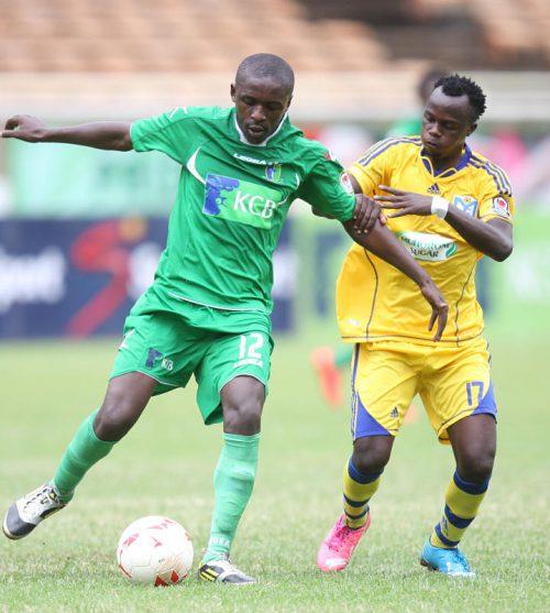 KCB Bethuel Warambo(L) and Ezekiel Odera of Sofapaka eye for ball possession during their KPL match at City Stadium on Saturday 11/07/15. PHOTO.BONIFACE OKENDO
