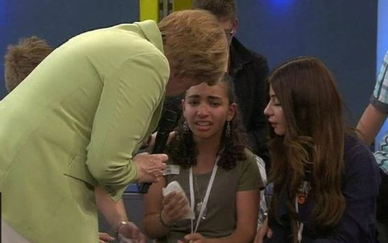 When Angela Merkel noticed the girl, Reem, was crying, she went to comfort her