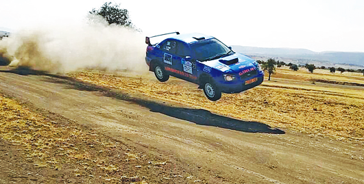 One of the rally cars, driven by Gurjit Singh Dhani, in action during the first leg of the U-track Nane-Nane Rally 2015 held in Arusha over the weekend.