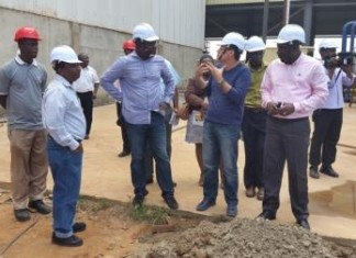 Mr Mahama Ayariga, Minister of Environment Science, Technology and Innovation and Mr Daniel Amlalo, the Executive Director led round by Mr Fadi El Chami, Deputy Managing Director of the USC.