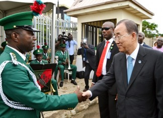 United Nations (U.N.) Secretary General Ban Ki-moon (R) shakes hands with an officer in charge of the guards brigade band, Captain Stephen Enwemuche, after addressing staff of the United Nations Agencies during his visit to the bombed UN's building in Abuja, capital of Nigeria, Aug. 24 2015. Ban Ki-moon is in Nigeria for an official two-day visit. (Xinhua/Dare Sholarin)