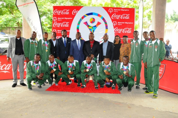 From left: Community Affairs Manager, Coca-Cola Nigeria Limited, Emeka Mba; Chairperson, Special Olympics Africa Region, Misan Eresanara; Board Member, Special Olympics Nigeria, Engr. Charles Yele Akindayomi; Managing Director, Coca- Cola Nigeria Limited, Adeola Adetunji; Board Chairman, Victor Osibodu; Director, Public Affairs & Communication, Coca-Cola Nigeria Limited, Clem Ugorji; Country Director, Special Olympics Nigeria, Naomi Saliu-Lawal; Board Member, Fumito Agusto with Nigeria's Unified Soccer Team during the Welcome Reception held for the 2015 Special Olympics Nigeria Team which took place at Vigeo Holdings, Ikoyi, Lagos recently.