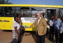 Mr Thomas Svanikier handing over the keys and documents on the bus to Madam Doris Owusu (left) (1)