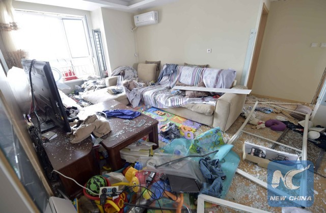 Photo taken on Aug. 13, 2015 shows an apartment damaged in the explosions in the Binhai New Area in Tianjin. (Xinhua/Yue Yuewei)