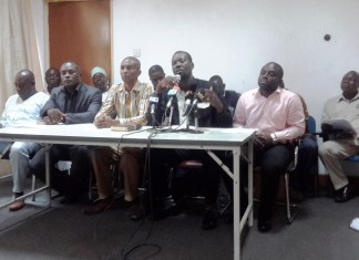 G. Armaah, Gen. Secretary with Mic, his right, Collins Kusi President and Emma Yirenkye Exec. Dir left side.
