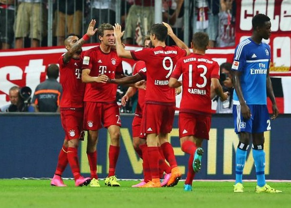 Gideon Jung watches on Bayern Munich players celebrate triumph over Hamburg