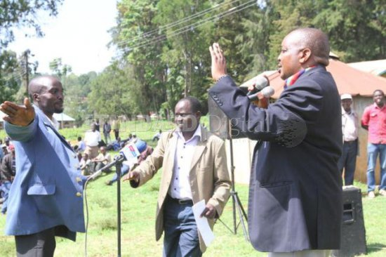 A resident of Baringo tries to stop Barwesa MCA Joseph Maklap (right) from addressing a public accountability forum called by Civil rights groups at Kabranet town on August 3,2015 to have the county executive account for million of shillings lost during the financial year 2013-2014.The report of the Auditor general had indicated that the county failed to account for some shillings 500 million. PHOTO:KIPSANG JOSEPH/STANDARD
