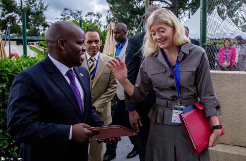 Minister Nsengimana (R) interacts with TVET trainees. (Emmanuel Ntirenganya)