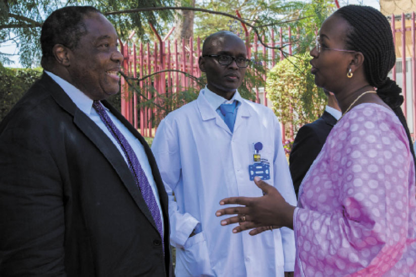 Ministry of Health permanent secretary Solange Hakiba (R) chats with Dr Milanga Mwanatambwe (L), an advisor to Tokushukai, and CHUK's Dr Richard Kyamatare. This was at the inauguration of the hemodialysis centre at University Teaching Hospital of Kigali (CHUK), yesterday. (Doreen Umutesi)